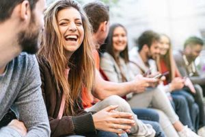 group laughing at an intensive outpatient treatment program