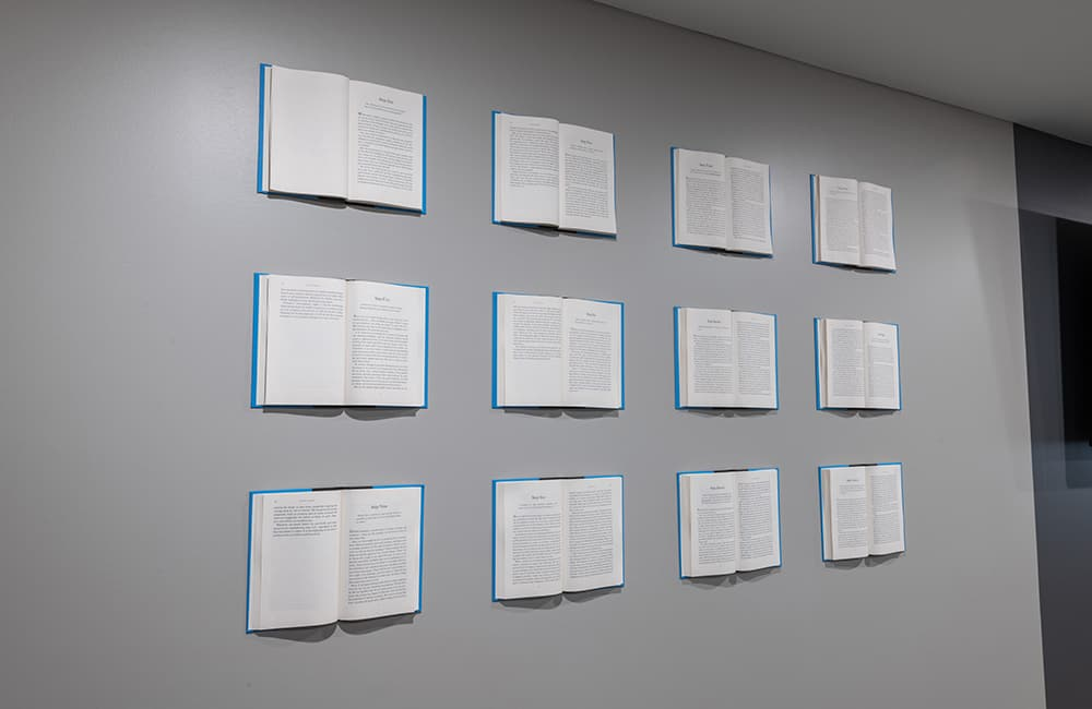 ethan crossing photo gallery books on wall